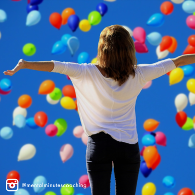 woman with hands out while balloons float by