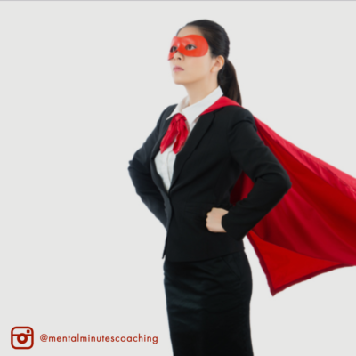 woman with cape standing in power pose stance