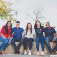 college students sitting on ledge