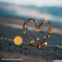 heart shape sticking out of the sand