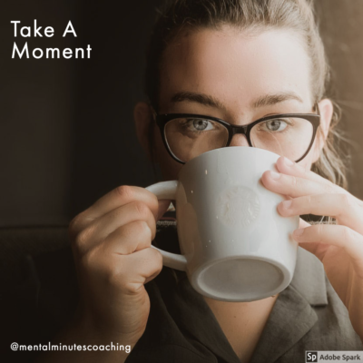 woman drinking from coffee cup