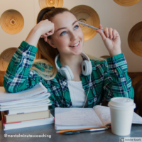 college girl studying with pile of books