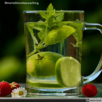 glass of water with lime slices